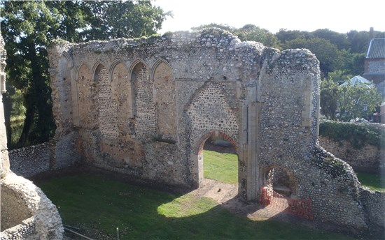 The south wall of the chancel, including 14th century arcading and a 19th century doorway (Norfolk County Council)