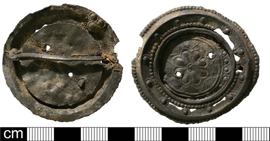 Photograph of lead alloy disc brooch